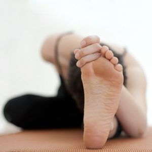 woman-stretching-feet